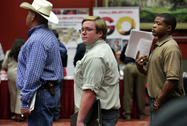 Blake Leslie, center, and Rodrick Griffin, right, wait in line to talk with company representatives during the Job Fair at the Texas Economic Developement & Energy Summit held at the Henry B. Gonzalez Convention Center, Thursday, August 23, 2012.  Leslie has been waiting on tables since he a graduated from Texas Tech in 2010. Photo: BOB OWEN, San Antonio Express-News / © 2012 San Antonio Express-News