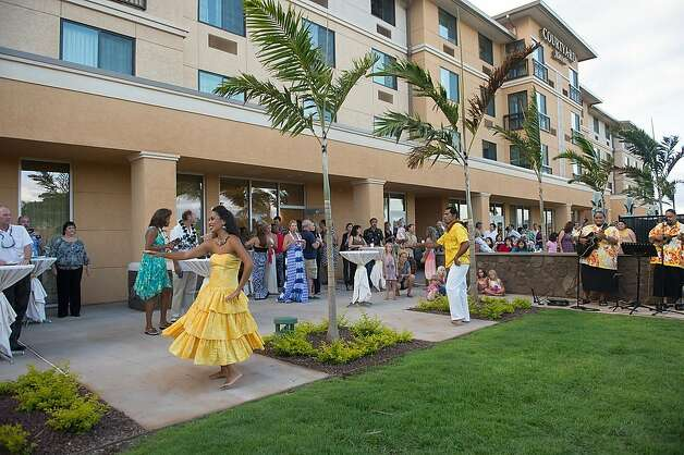 The new Courtyard by Marriott in Kahului celebrated its grand opening last month with hula and a traditional Hawaiian blessing. It's about a mile from the airport, and offers surfboard storage for those hitting the waves in Paia and other nearby beaches. Photo: Jeanne Cooper, Special To SFGate