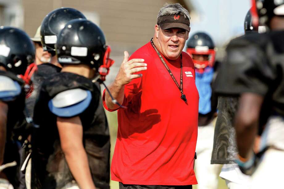 Wagner coach Pete Gibbens directs traffic during a Wagner practice, in preparation for Friday's opener against Reagan at Comalander Stadium. Photo: Marvin Pfeiffer, Marvin Pfeiffer / NE Herald / Prime Time Newspapers 2012
