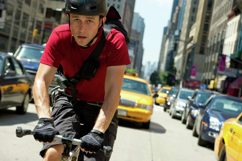 "Bike messenger Wilee (Joseph Gordon-Levitt) picks up an envelope and gets chased around Manhattan in ""Premium Rush."" Photo: Sarah Shatz / Columbia Pictures - Sony"