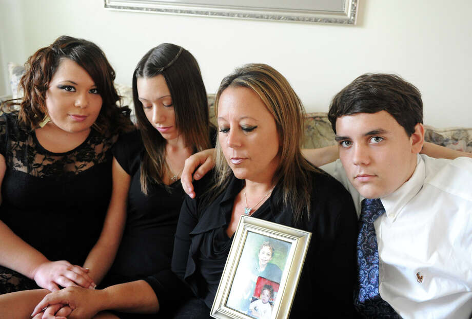 Deborah Bella and her children, from left, Jackie, 20, Nicole, 19, and Brandon, 16, photographed in the family home in Stamford, Conn., August 23, 2012. Kevin Bella, 13, was killed in a motorcycle accident last week. Photo: Keelin Daly / Stamford Advocate
