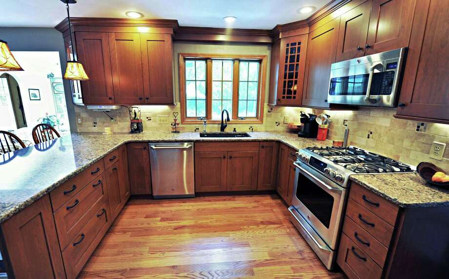 Kitchen cabinets at Linda Seymour's Burnt Hills home Thursday Aug. 9, 2012.  (John Carl D'Annibale / Times Union) Photo: John Carl D'Annibale / 00018743A