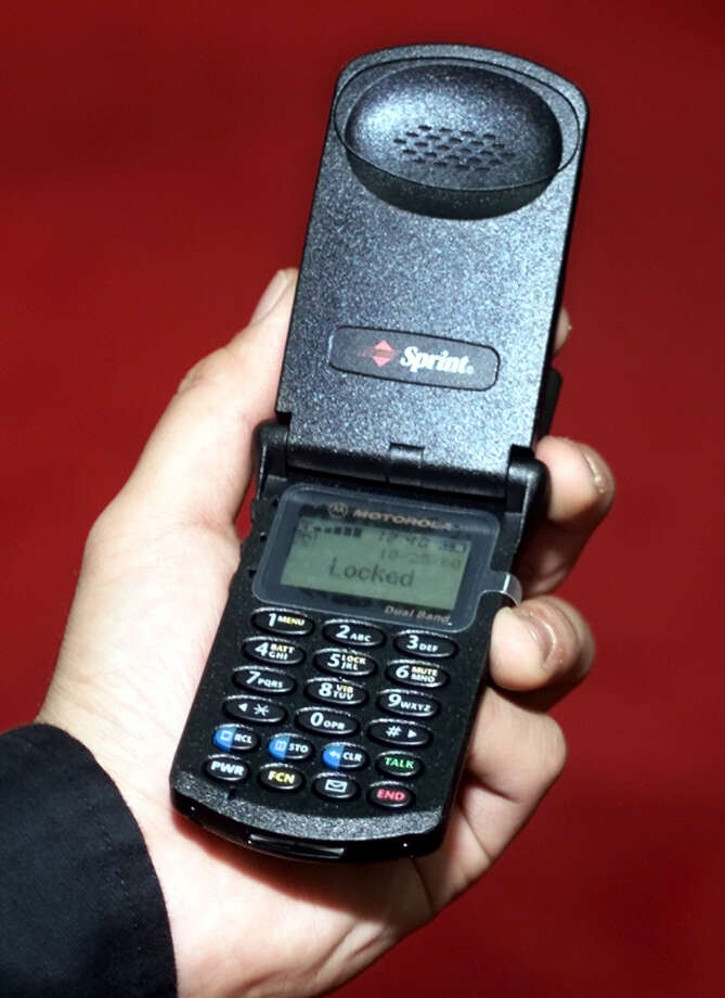 In 1996, Motorola's StarTAC proved that cell phones didn't have to look like bricks. It was the first flip phone. This is a model from 2000. Photo: ED BAILEY, AP / AP