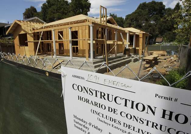 Bay Area homes, like this one under construction in Palo Alto, cost more. Prices could fall if the tax deduction for interest paid on home mortgages is eliminated. Photo: Paul Sakuma, Associated Press