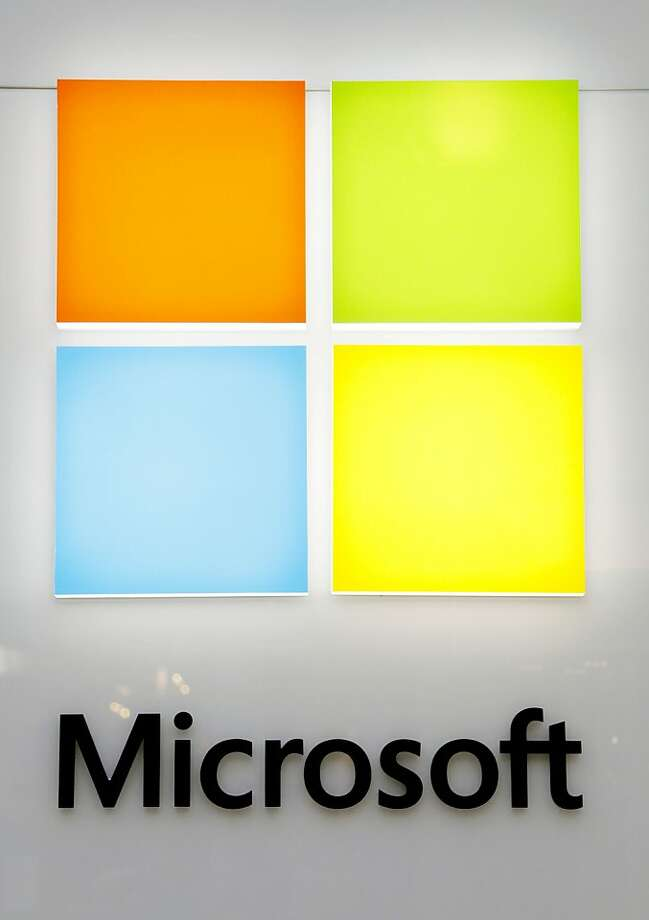 Microsoft recently took the wave out of its Windows logo, while also toning down the colors. Photo: Steven Senne, Associated Press