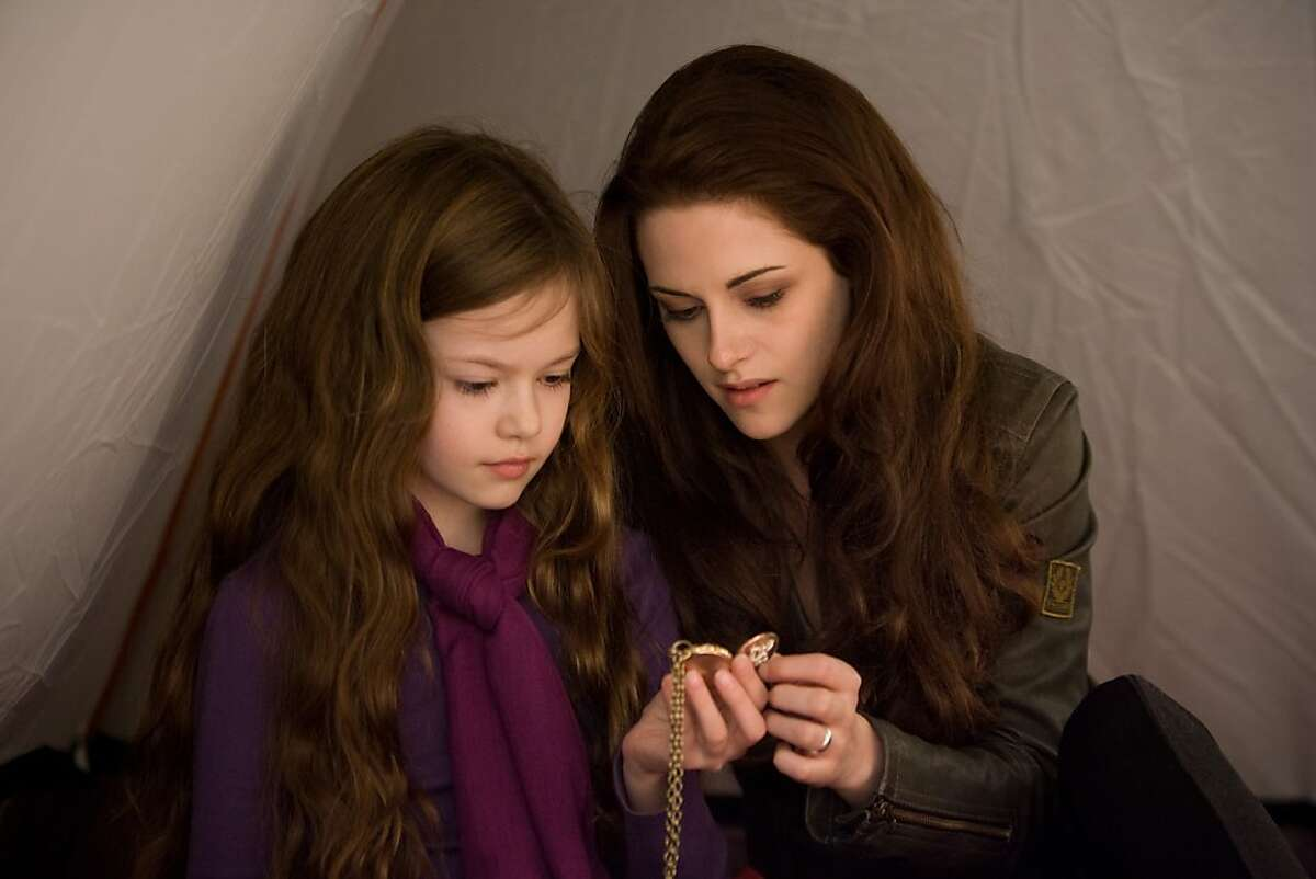 """This film image released by Summit Entertainment shows Mackenzie Foy, left, and Kristen Stewart in a scene from """"The Twlight Saga: Breaking Dawn Part 2."""" (AP Photo/Summit Entertainment, Andrew Cooper)"""