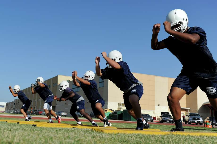 Roosevelt offensive linemen break out of their stance during a recent practice drill. Photo: John Albright, John Albright / For The NE Heral