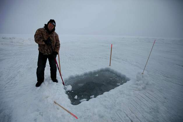 "Vince Skiba digs the dive hole on ""Bering Sea Gold: Under the Ice."" Photo: David Reichert"