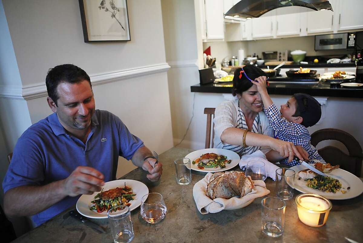Will and Karen Gioia eating dinner with their son Julian at their home in San Francisco, Calif. on Monday, July 30, 2012.