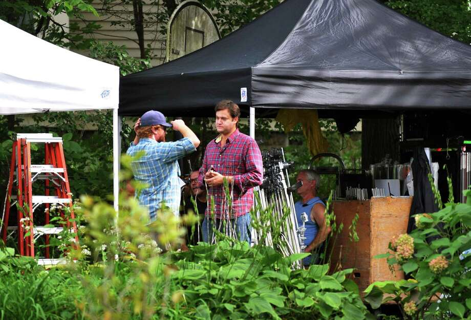 "Movie producer Jamie Patricof, center, on the set of ""The Place Beyond the Pines,"" on Wendell Ave. in Schenectady Thursday Sept. 22, 2011.   (John Carl D'Annibale / Times Union) Photo: John Carl D'Annibale"