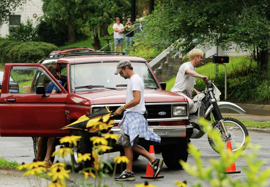 "Actors Eva Mendes,left, and Ryan Gosling on the set of ""The Place Beyond The Pines"" on Watt Street in Schenectady, NY Tuesday Aug. 9,2011.( Michael P. Farrell/Times Union) Photo: Michael P. Farrell"