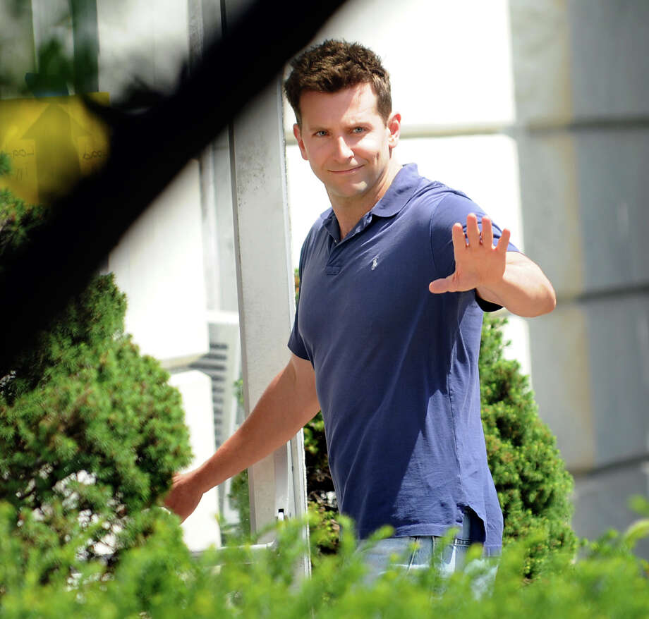 Bradley Cooper waves to his fans as he enters City Hall for the day's filming of ?The Place Beyone the Pines? on Friday, Aug. 12, 2011, in Schenectady, N.Y. (Cindy Schultz / Times Union) Photo: Cindy Schultz