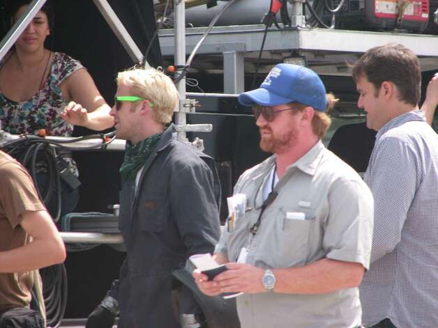 "Ryan Gosling during a break in the filming of ""The Place Beyond the Pines"" on Route 5 in Glenville. Gosling was riding a motorcycle for a scene in the film. Producer, Jamie Patricof is pictured at right. (Desiree LaBombard / Special to the Times Union)"
