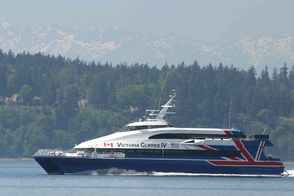 The Victoria Clipper on Puget Sound with the Olympic Mountains in the background. Photo by Joshua Trujillo / Seattle P-I