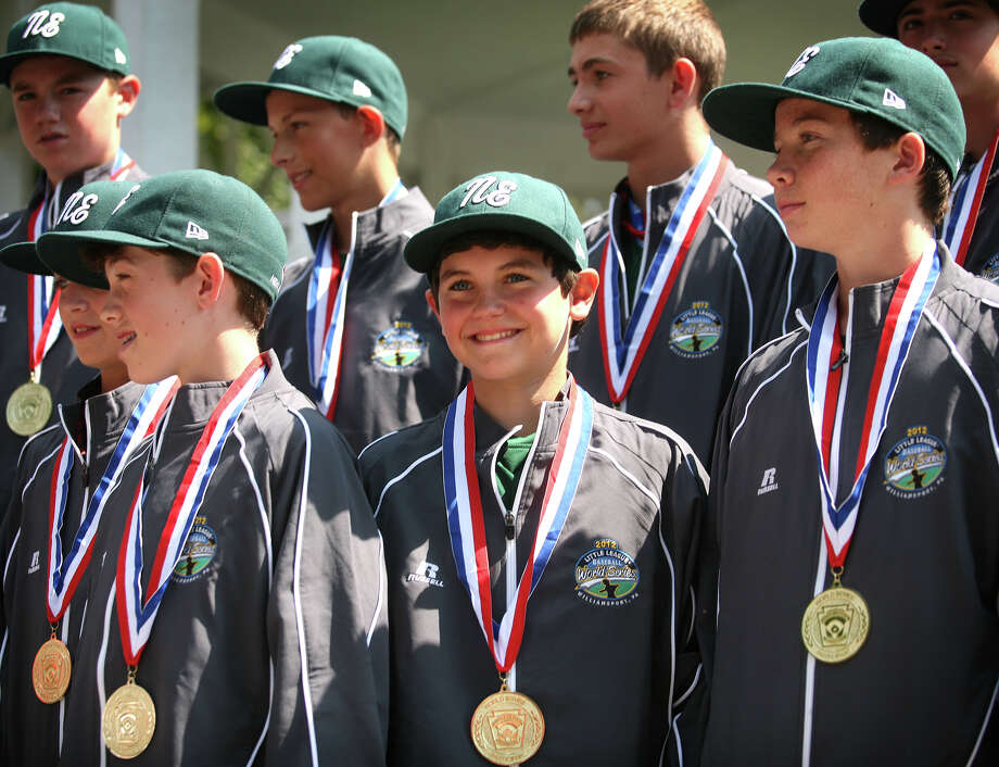 Kevin Oricoli, center, smiles as he and his teammates on the  Fairfield American Little League team are welcomed home from Williamsport, PA in a ceremony on the Sherman Green in downtown Fairfield on Thursday, August 23, 2012. Photo: Brian A. Pounds / Connecticut Post