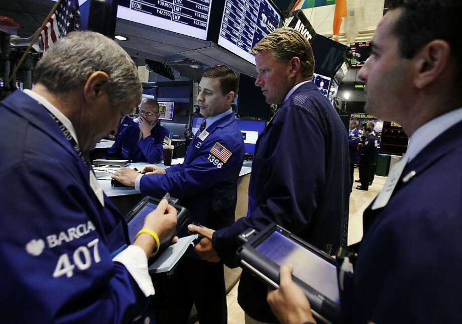 Stocks faltered after reports that the Federal Reserve may not take further action to boost the economy. Photo: Richard Drew, Associated Press