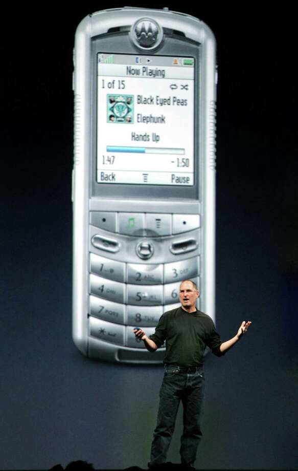 Steve Jobs in 2004 unveiled the short-lived Motorola ROKR, the first smartphone that worked with Apple's iTunes. It was considered a flop, but the lessons Apple learned were applied to the iPhone.  Photo: LOU DEMATTEIS, REUTERS / X00082