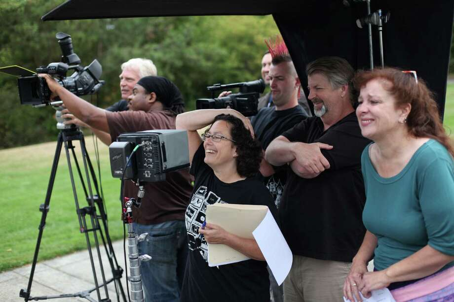 "Producer Erren Gottlieb, center, watches on a monitor with other crew during a shoot for the new show ""The (206)"" on Thursday, August 23, 2012 at Mercer Island's Park on the Lid. The show is being produced by many of the original creators of popular television show ""Almost Live"" and will feature original comedic sketches. Photo: JOSHUA TRUJILLO / SEATTLEPI.COM"