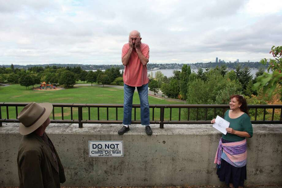 """Comedian John Keister, center, practices a comedic sketch with Pat Cashman, left, as Keister's wife and show writer Mary McKinley holds up cues during a shoot for the new show """"The (206)"""" on Thursday, August 23, 2012 at Mercer Island's Park on the Lid. The show is being produced by many of the original creators of popular television show """"Almost Live"""" and will feature original comedic sketches. Photo: JOSHUA TRUJILLO / SEATTLEPI.COM"""
