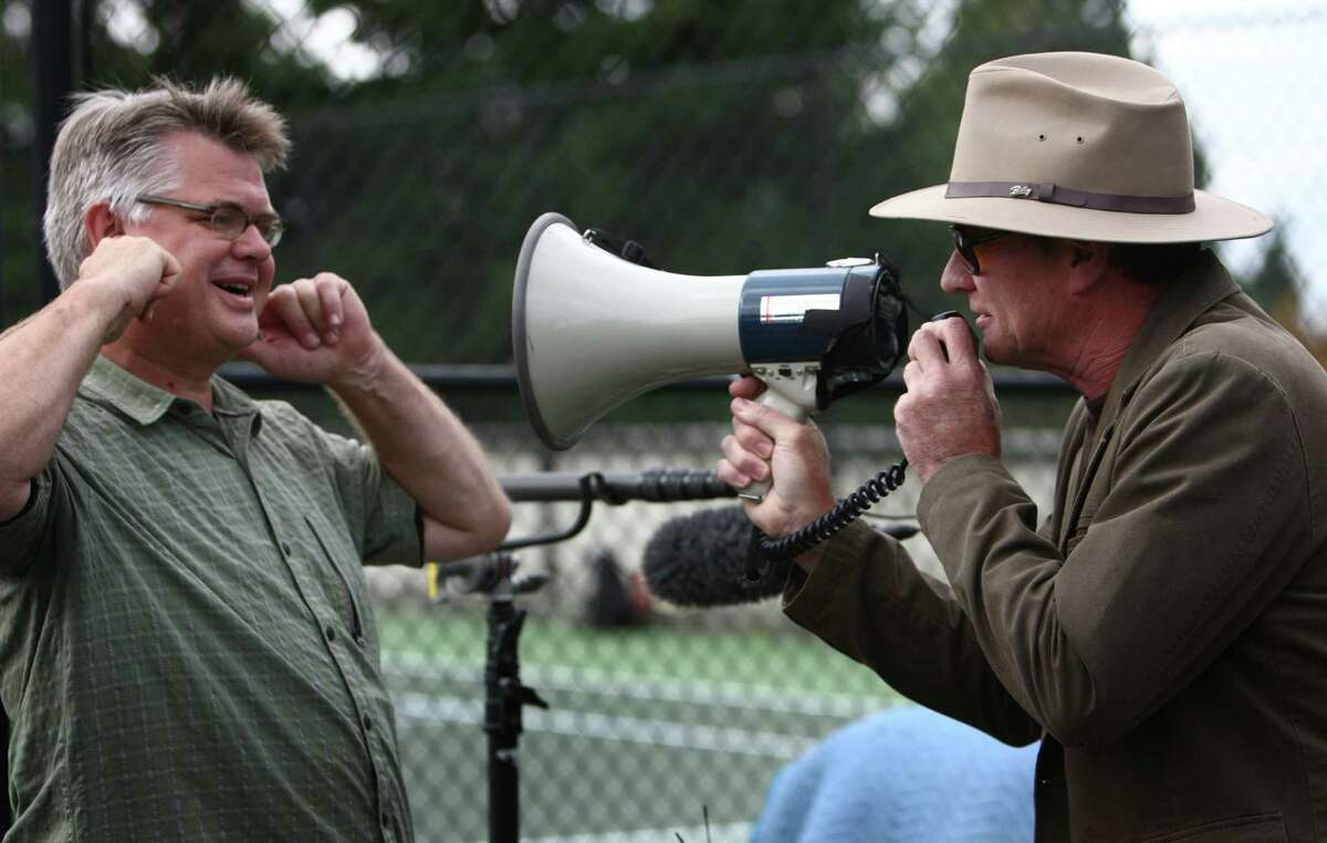 Comedian Pat Cashman has some fun with a bullhorn and soundman Todd Schmidt during a shoot for the new show
