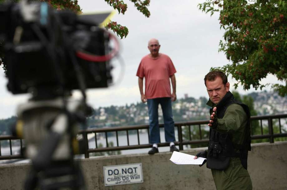 "Comedian John Keister, center, performs a comedic sketch with actor and comedian Chris Cashman during a shoot for the new show ""The (206)."" Photo: JOSHUA TRUJILLO / SEATTLEPI.COM"