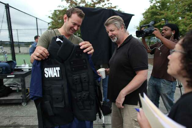 "Comedian Chris Cashman checks out his costume with co-producer Jim McKenna during a shoot for the new show ""The 206"" on Thursday, August 23, 2012 at Mercer Island's Park on the Lid. The show is being produced by many of the original creators of popular television show Almost Live and will feature original comedic sketches. Photo: JOSHUA TRUJILLO / SEATTLEPI.COM"