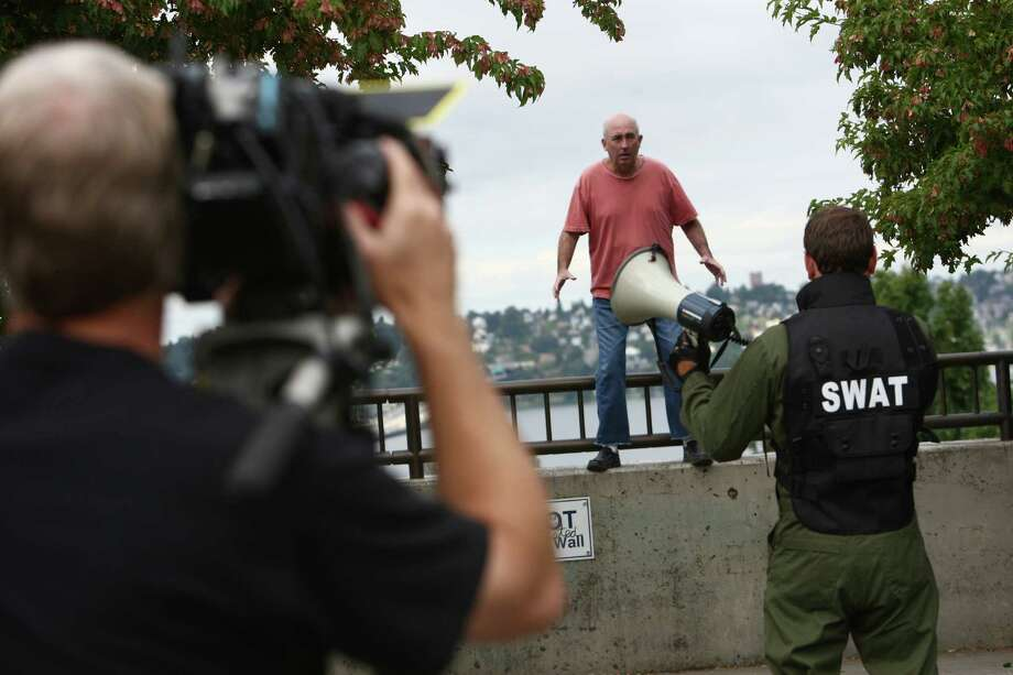 Director of photography Mike Boydstun, left, shoots as John Keister and Chris Cashman perform. Photo: JOSHUA TRUJILLO / SEATTLEPI.COM