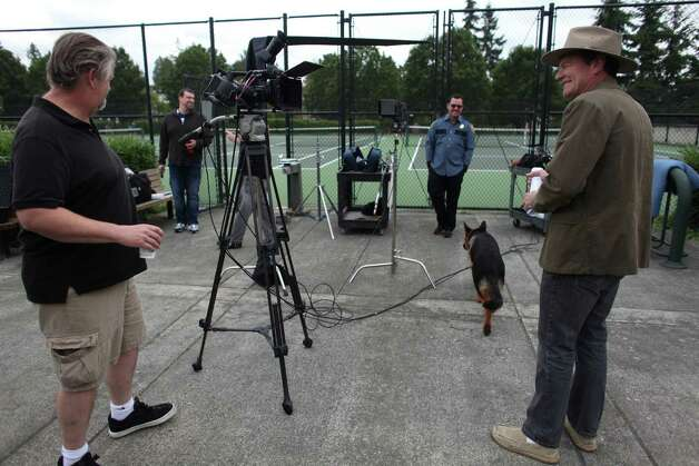 "Co-producer Jim McKenna and comedian Chris Cashman watch as a dog walks through the set during a shoot for the new show ""The 206"" on Thursday, August 23, 2012 at Mercer Island's Park on the Lid. The show is being produced by many of the original creators of popular television show Almost Live and will feature original comedic sketches. Photo: JOSHUA TRUJILLO / SEATTLEPI.COM"