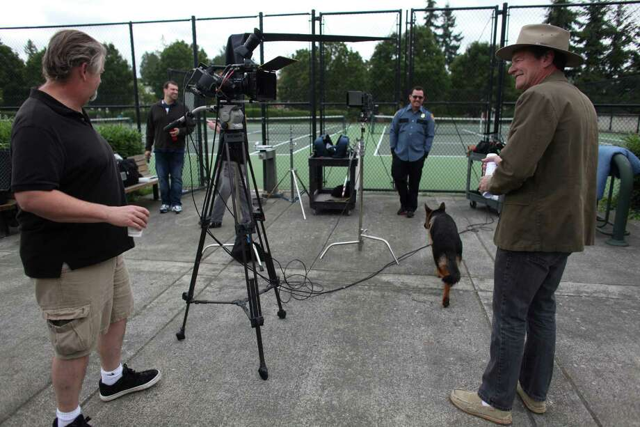 "Co-producer Jim McKenna and comedian Chris Cashman watch as a dog walks through the set during a shoot for the new show ""The (206)."" Photo: JOSHUA TRUJILLO / SEATTLEPI.COM"