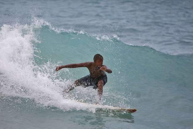 A boy surfs a wave at a beach in Barahona, Dominican Republic, before the anticipated arrival of Tropical Storm Isaac, Thursday, Aug. 23, 2012. U.S. forecasters said Isaac will likely turn into a Category 1 hurricane by Friday as it nears the Dominican Republic and Haiti. (AP Photo/Ricardo Arduengo) Photo: Ricardo Arduengo, Associated Press