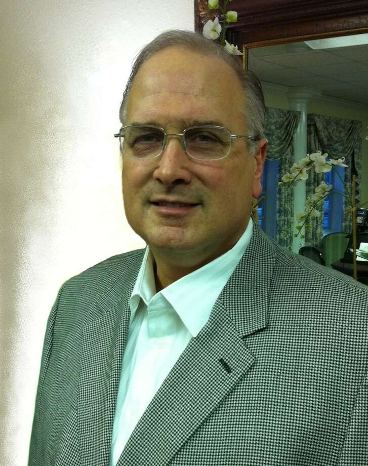 Douglas A. McClain Sr. is accused of scamming $200,000 from Dr. Charles Arnold, of San Antonio. Photo: Courtesy Photo