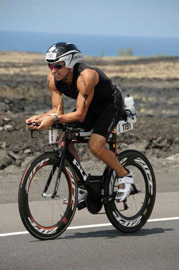 Greenwich's Craig Vitale placed 44th out of a field of more than 2,100 triathletes at the 2012 Ironman U.S. Championship in New York on Aug. 11, earning a spot in the Ironman World Championship in Kailu-Kona, Hawaii on Oct. 13. The former Greenwich High School football star finished the 140.6-mile event in a personal-record time of 9 hours, 38.05 seconds. Photo: Contributed Photo / Stamford Advocate Contributed