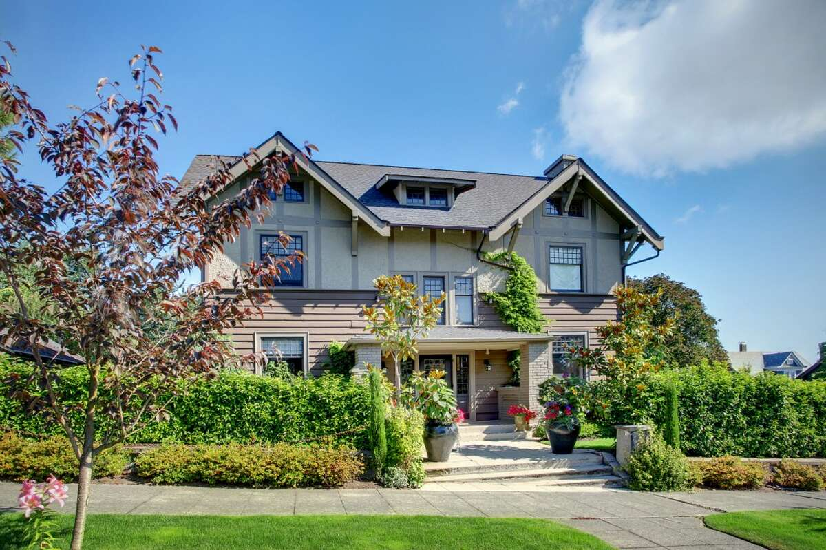 Here's a sweet Roanoke Park Craftsman home with modern updates, at 918 E. Hamlin St. The 4,910-square-foot house, built in 1910, has six bedrooms, including a master bedroom with a fireplace, 2.25 bathrooms, a two-story entry, exposed fir doors, paneling, moldings and beams, a lower-level media/rec room with a wet bar and a patio on a manicured, 6,600-square-foot corner lot. It's listed for $1.595 million.