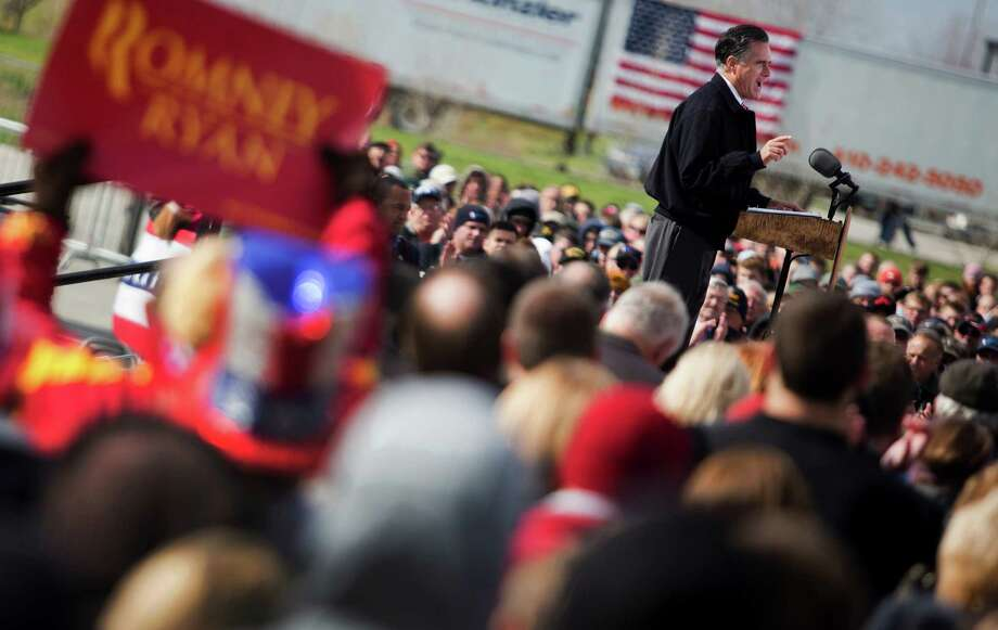 Mitt Romney, the Republican presidential candidate, speaks during a campaign event at Kinzler Construction Services in Ames, Iowa, Oct. 26, 2012. National polls show a close race between Romney and President Barack Obama among likely voters. Photo: STEPHEN CROWLEY, New York Times / NYTNS