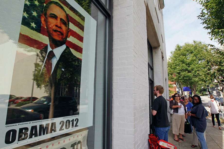 People wait outside a campaign field office in Raleigh, N.C., Thursday, Aug. 23, 2012 to receive credentials for President Barak Obama's acceptance speech during Charlotte's Democratic Convention. (AP Photo/Gerry Broome) Photo: Gerry Broome, Associated Press / AP
