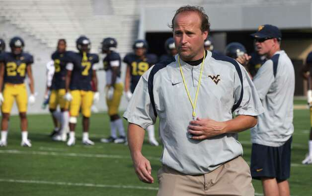 West Virginia University Mountaineers Head Coach Dana Holgorsen keeps a close eye on his team during a practice. The Mountaineers is the newest team to join the Big 12 Conference. Thursday, Aug. 9, 2012. Photo: Bob Owen, Express-News / © 2012 San Antonio Express-News