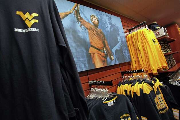 A poster of West Virginia University Mountaineer is displayed with team clothing gear in the Barnes and Nobles on campus, in Morgantown, West Virginia.  Thursday, Aug. 9, 2012. Photo: Bob Owen, Express-News / © 2012 San Antonio Express-News