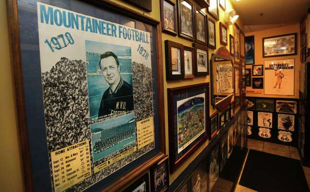 Old West Virginia University Mountaineers posters and photos including one of 1970 Coach Bobby Bowden on the walls of Varsity Club which is across the street from Milan Puskar Stadium.  WVU is the newest team to join the Big 12 Conference, in Morgantown, West Virginia.  Thursday, Aug. 9, 2012. Photo: Bob Owen, Express-News / © 2012 San Antonio Express-News