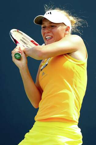 NEW HAVEN, CT - AUGUST 23:  Caroline Wozniacki of Denmark returns a shot to Dominika Cibulkova of Slovakia during the New Haven Open at Yale at the Connecticut Tennis Center at Yale on August 23, 2012 in New Haven, Connecticut.  (Photo by Matthew Stockman/Getty Images) Photo: Matthew Stockman, Getty Images / 2012 Getty Images