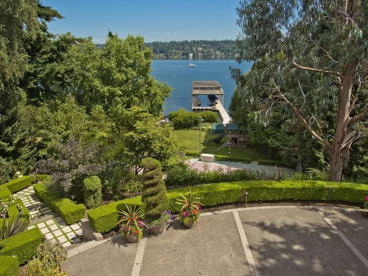 Overview of this high-tech home in Seward Park. The 2.35-acre property includes a 11,400-square-foot main house, a secondary home, cabana, 131 feet of waterfront and the largest dock and boathouse on Lake Washington, according to the listing. The main home features systems controllable via iPad or iPhone; a media server that allows people to watch different movies at the same time in different rooms; several rooms with theater surround sound and high-quality video; a programmable lighting system; a security system with multiple independent zones, remote monitoring, cameras and monitoring for fire, gas breaks and motion detection; remote access controls; a high-tech gym; a PBX system with phones and an intercom in every room; automated blackout curtains; two commercial grade water heaters and five independent furnace/air-conditioners with computerized controls; a pool; a sport court; and patios and decks. The address is undisclosed. It's listed for $9.888 million.