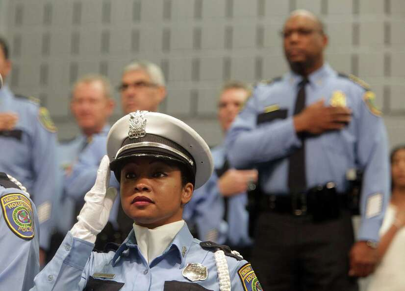HPD Honor Guard Officer T. Jefferson salutes while the National Anthem is sung during The Houston Po