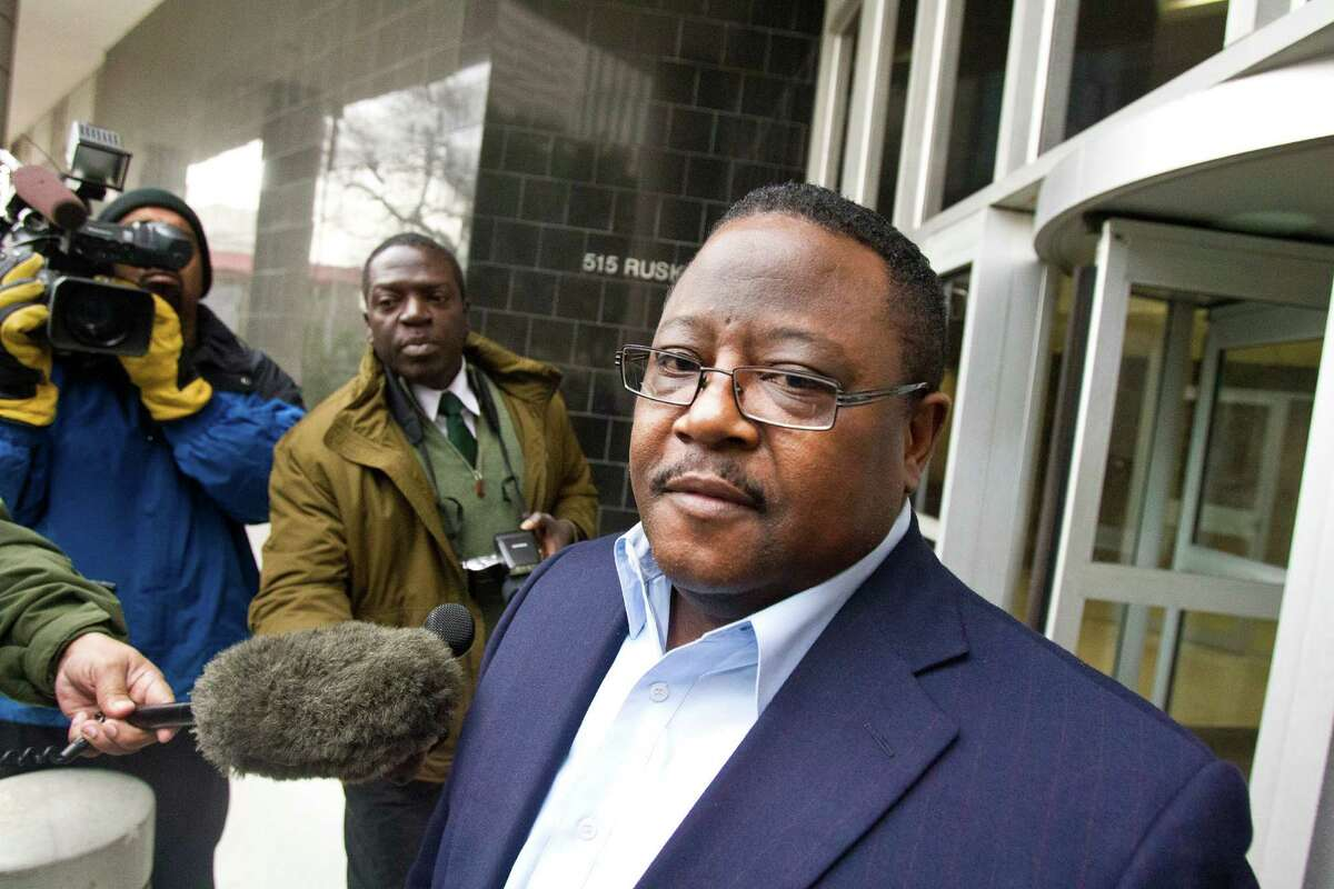 Michael Butler, the former office manager of Harris County Precinct One Constable, tells the media to ask his attorney questions outside the Bob Casey Federal Courthouse Thursday, Jan. 12.