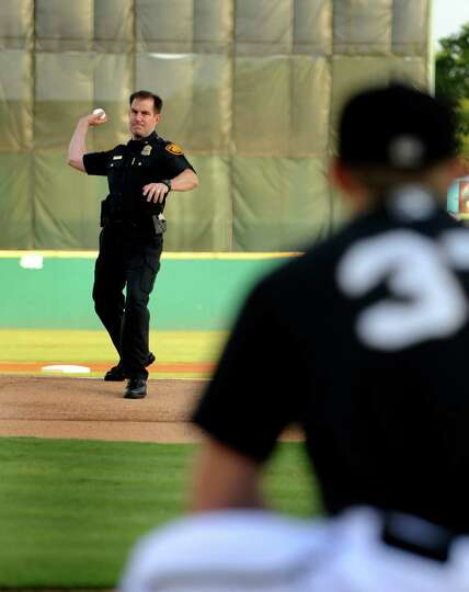 San Antonio Police Deputy Chief Anthony Trevino throws out the first pitch before the Frisco Roughri