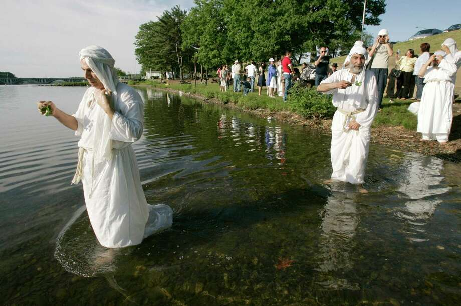 Mandaeans, such as this group from Iraq living in Worcester, Mass., are able to escape religious persecution and relocate in the U.S. thanks to the Lautenberg Amendment. Photo: Associated Press / AP