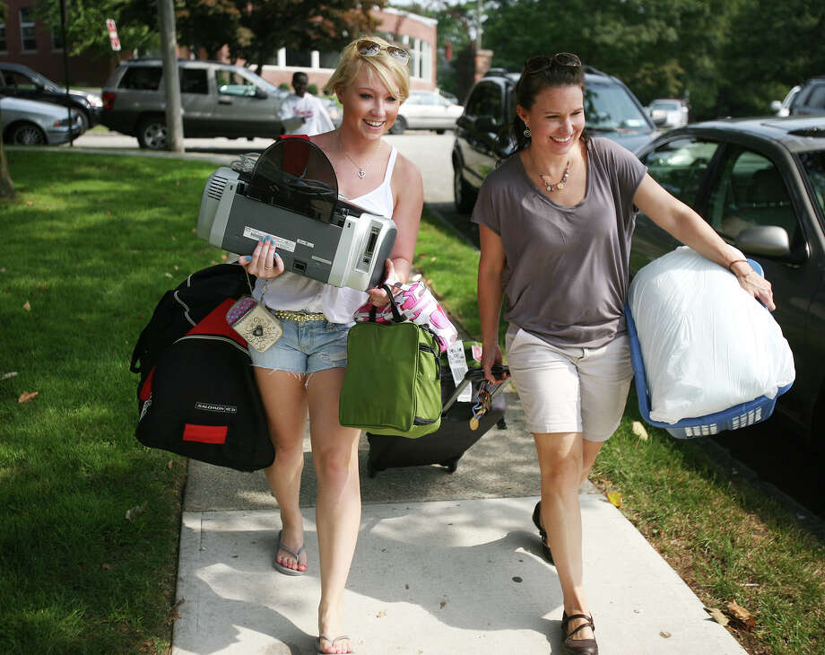 Freshman Cailyn Klarich, 18, and her mom Carlene Exline from Cleveland, Ohio move Cailyn's things into the dorms at the University of Bridgeport on Thursday, August 23, 2012. Photo: Brian A. Pounds / Connecticut Post