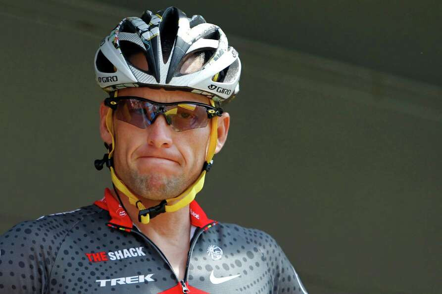 FILE - In this July 6, 2010, file photo, Lance Armstrong grimaces prior to the start of the third st