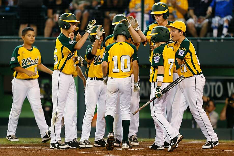 SOUTH WILLAMSPORT, PA - AUGUST 23:  Hance Smith #10 of the West team from Petaluma, California celebrates his solo home run against the Southwest team from San Antonio, Texas during the first inning of their Little League World Series game on August 23, 2012 in South Willamsport, Pennsylvania.  (Photo by Rob Carr/Getty Images) Photo: Rob Carr, Getty Images