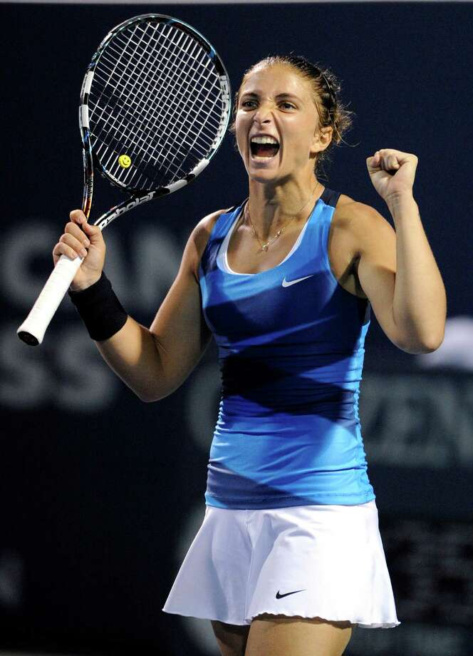 Sara Errani, of Italy, celebrates after her 6-4, 6-3 win over Marion Bartoli, of France, in their quarterfinal match at the New Haven Open tennis tournament in New Haven, Conn., on Thursday, Aug. 23, 2012. (AP Photo/Fred Beckham) Photo: Fred Beckham, Associated Press / FR153656 AP