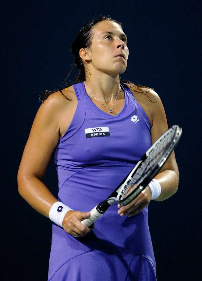 Marion Bartoli, of France, reacts after losing a point in her 6-4, 6-3 loss to Sara Errani, of Italy, during a quarterfinal at the New Haven Open tennis tournament in New Haven, Conn., on Thursday, Aug. 23, 2012. (AP Photo/Fred Beckham) Photo: Fred Beckham, Associated Press / FR153656 AP