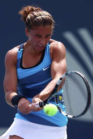 NEW HAVEN, CT - AUGUST 21:  Sara Errani of Italy returns a shot to Carla Suarez Navarro of Spain during the New Haven Open at Connecticut Tennis Center at Yale on August 21, 2012 in New Haven, Connecticut.  (Photo by Joe Scarnici/Getty Images) Photo: Joe Scarnici, Getty Images / 2012 Getty Images